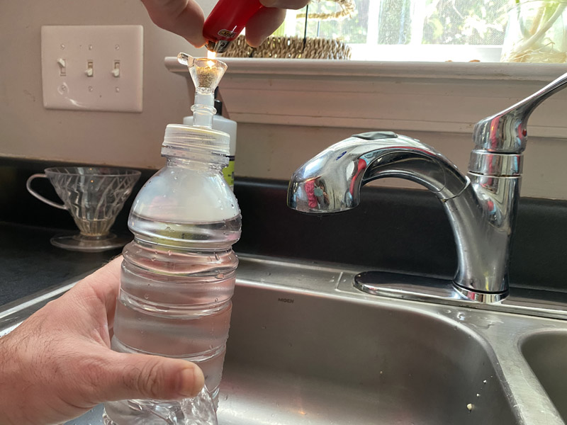 Hold your gravity bong over a sink. Put a flame to your bowl and release your finger from the carb.